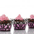 Three Chocolate cupcakes with pink butter icing — Stock Photo #10368411