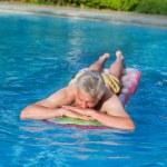 Elderly man floating on air mattress — Stock Photo #10368455