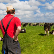 Farmer with cattle cows — Stock Photo #10368590