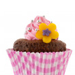 Pink chocolate cupcake with flower — Stock Photo