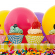 Stock Photo: Birthday cupcakes with balloons