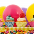 Birthday cupcakes with balloons - Stock Photo