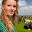 Dutch girl in field with cows - Lizenzfreies Foto
