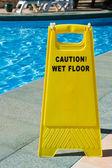 предостерегите влажный пол — Стоковое фото