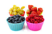 Fresh fruit in colorful cups — Stock Photo
