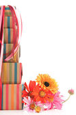 Colorful wrapped presents and flowers — Stock Photo