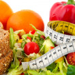 Diet meal with measuring tape — Stock Photo