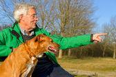 Man with dog — Stock Photo