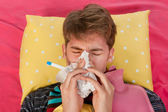 Very ill man is blowing his nose — Stock Photo