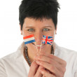Young woman with English Dutch flags — Stock Photo #8768511