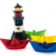 Colorful paper boats with lighthouse — Stock Photo