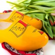 Dutch wooden clogs with tulips — Stock Photo