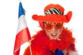 Mulher holandesa com bandeira como fã de futebol — Fotografia Stock