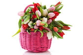 Pink basket with tulips — Stock Photo
