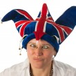 Woman with cross eyes to Brittain funny hat — Stock Photo #9577835