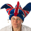 Stock Photo: Womwith cross eyes to Brittain funny hat