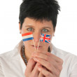 Young woman with English Dutch flags — Stock Photo