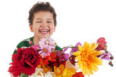 Laughing boy with flowers — Stock Photo
