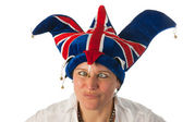 Woman with cross eyes to Brittain funny hat — Stock Photo