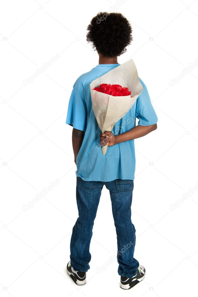 Black teenager with bouquet roses for surprise — Stock Photo #9577769