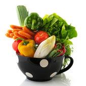 Black bowl full vegetables — Stock Photo