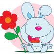 Bunny Holds Flower - Foto Stock
