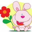 Happy Pink Bunny Rabbit Holding A Flower - Stock Photo