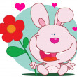 Pink Bunny Holds Flower - Stock Photo