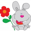 Happy Bunny Holds Flower - Stock Photo