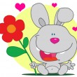 Grey Bunny Holds Flower - Foto Stock