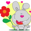 Grey Bunny Holds Flower - 图库照片