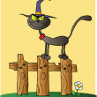 Halloween Witch Cat On A Fence Over Yellow - Foto Stock