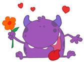 Paarse monster houden een bloem — Stockfoto