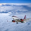 Airplane in cloudscape with sunset — Stockfoto #10699102