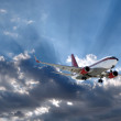 Airplane and sun behind — Stock Photo
