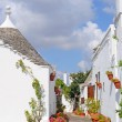 Trulli houses in Alberobello, Italy - Stock Photo