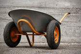 Orange farmer's two wheelbarrow — Stok fotoğraf