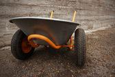 Orange farmer's two wheelbarrow — 图库照片