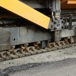 Stock Photo: Aspahlt paving machine's track