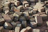 Thrown beige pavement blocks — Stock Photo