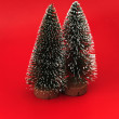 Two christmas trees on red background — Foto de stock #9548164