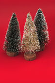 Three christmas trees on red background (Capture 1) — ストック写真