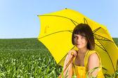 Young girl with yellow umbrella . — Stock Photo