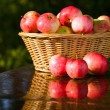 Ripe apples in wicker basket. — Stock Photo
