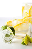Drinks with lemon and lime. — Stock Photo