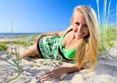 Young woman on a beach. — Stock Photo