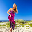 Womin purple sundress on beach. — Stock Photo #9639188