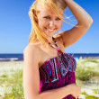 Foto Stock: Happy womin purple sundress .