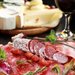 Salami and cheese platter with herbs — Stock Photo #10271310