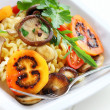 Pasta with mushrooms and tamarillos - Stock Photo